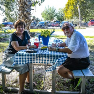 Guests relaxing in the shady Children's Garden, Brick by Brick Picnic at Lakes Regional Park, 03-18-2018