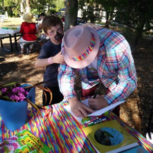 Zombie vs. Zaniac - a young guest gets author Scott P Smith to autograph his book at our Brick by Brick Picnic, 03-18-2018