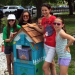 Members of Troop 292 with their latest creation, a Little Free Library they built for the Children's Garden at Lakes Regional Park in Fort Myers, FL