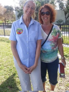 Courtney Fraser from Eat Local Lee (left) visited the Lakes Park Community Garden to talk about locally-grown food.