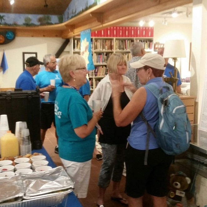 Lakes Park Ambassadors Bonnie Ryan and Kathy Busick mingle with other volunteers at the Train Museum brunch.