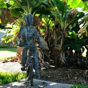 statue of boy on a bike
