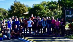 Staff members from the Gartner Group volunteering at the Lakes Park Botanic Garden