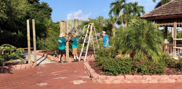 Construction of a trellis in the Rose Garden at Lakes Park by volunteers.